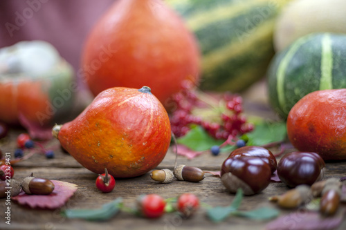 Fototapety, obrazy: Autumn background,   pumpkins and fallen leaves on wooden background