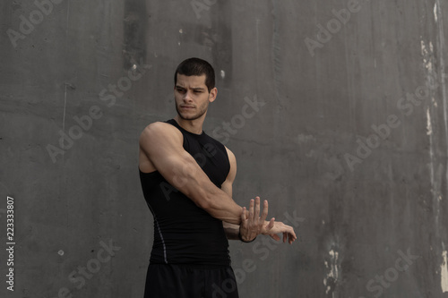 Fotografiet  Strong muscular, sporty man warming up, getting ready for traini
