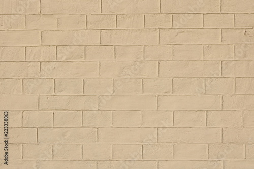 Fotografía  faded natural yellow clay background with brick texture