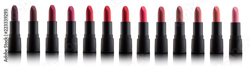 Fotografiet Palette of color lipsticks isolated on white