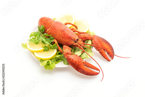 Leinwand Poster freshly boiled lobster with vegetable and lemon