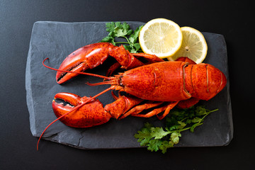 lobster with vegetable and lemon on black slate plate