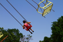 Girl On Old Chain Carousel In Park Against Blue Sky, Photo Of People