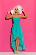 canvas print picture - Sexy Blond Woman In Sun Hat, Turquoise Dress And High Heels