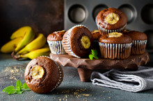 Chocolate Muffins With Banana On Concrete Background