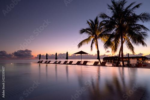 Obraz na plátně  Beautiful poolside and sunset sky