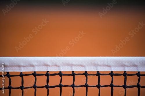 tennis court net, outside in a tennis court