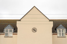 Minimalist Design Of English Building Wall With Clock On It