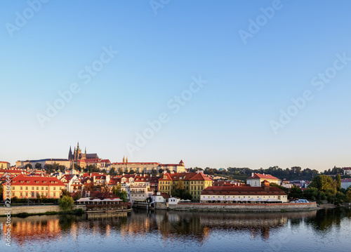 Photo  View over Vltava River towards Lesser Town and Castle at sunrise, Prague, Bohemi