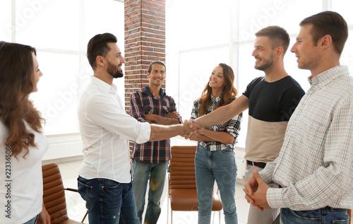 Staande foto Hoogte schaal view from the top.handshake of businessmen
