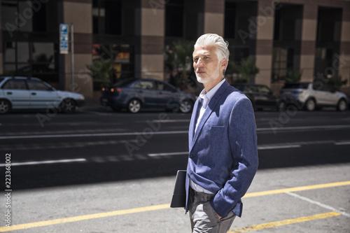 Serene businessman walking in the street
