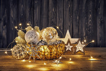 Christmas Decoration In Wicker Basket With Electric Garland