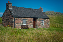 Red Stone Cottage With Slate Roof, Isle Of Iona, Inner Hebrides, Scotland