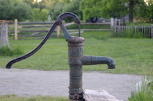 Old Fashioned Water Pump On Farm