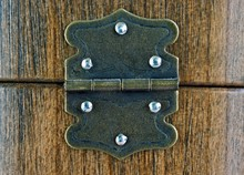 Old Dusty Rustic Hinge On Wooden Box Background
