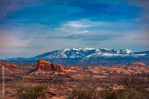 Snow Capped Peaks And Cloudy Skies In Moab Utah