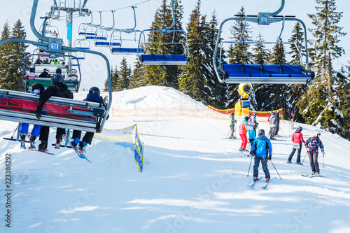 Winter holidays in the mountains. Mountain-skiing resort in the Carpathians.several skiers on a snowy road