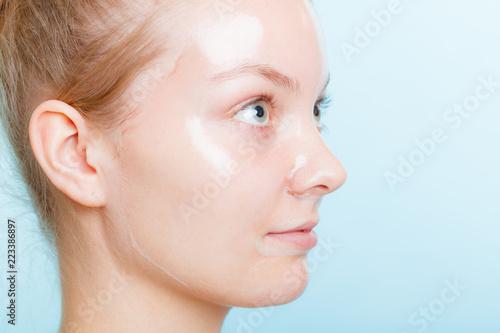 Fotografie, Tablou  Close up woman in facial peel off mask.