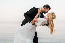 Affectionate Wedding Couple Go...