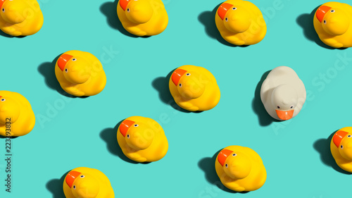 One out unique rubber duck concept on a blue background Canvas Print