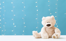 A Teddy Bear On A Shiny Light Blue Background
