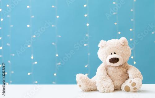 Fototapeta  A teddy bear on a shiny light blue background