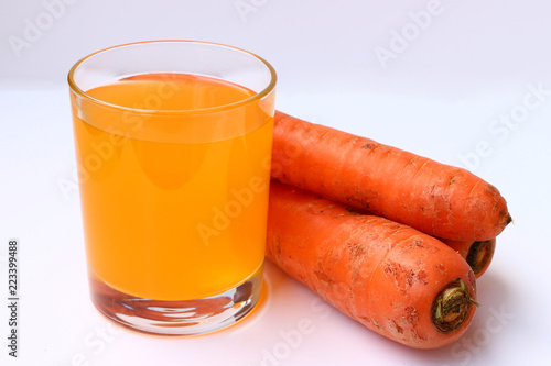 Foto op Canvas Sap Carrots and juice on a white background are isolated