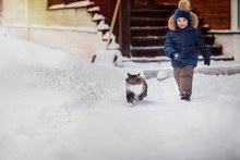 Boy Running With Fluffy Cat