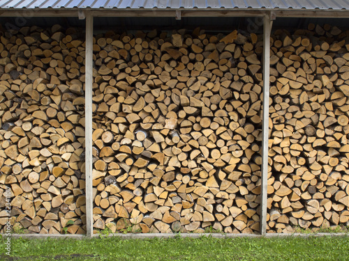 wall firewood , dry chopped firewood logs in a pile prepared fo