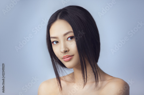 Asian Beauty Woman Skin Care Close Up Beautiful Young With Perfect Face Looking At Camera Isolated On Gray Background Tender Smiling Mixed Race