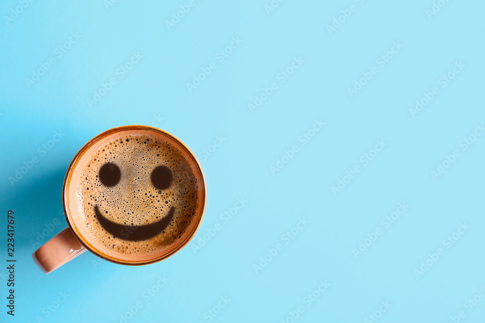 Fototapeta Cup of aromatic hot coffee on color background