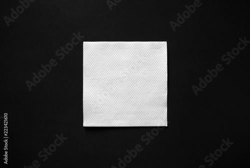 Obraz na plátně Blank white paper napkin on black background with copy space