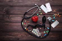 Black Ribbon With Pills And Stethoscope. Melanoma Concept