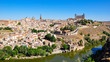 Panoramic view of the center of Toledo with the Tajo (Tagus) river, Alcazar and tower of Toledo Cathedral. Toledo is a medieval town and a former capital of Spain