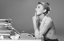 Young Blonde Female Writer Using Typing Machine