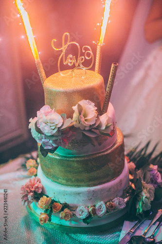 Super Big Beautiful Golden Wedding Cake With Flowers And Sparklers Or Funny Birthday Cards Online Elaedamsfinfo