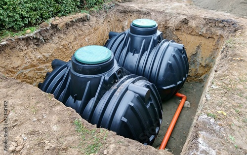 Valokuva  Two plastic underground storage tanks placed below ground for harvesting a rainwater