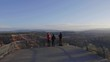 Tourists on the overlook at Bryce Point during sunrise in slow motion.