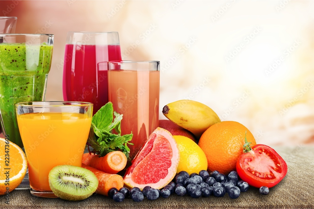 Fototapeta Composition of fruits and glasses of juice