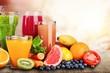 Leinwandbild Motiv Composition of fruits and glasses of juice