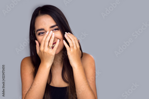 Photo Adorable fun cute shy bashful hispanic female laughing, playful, isolated, cover