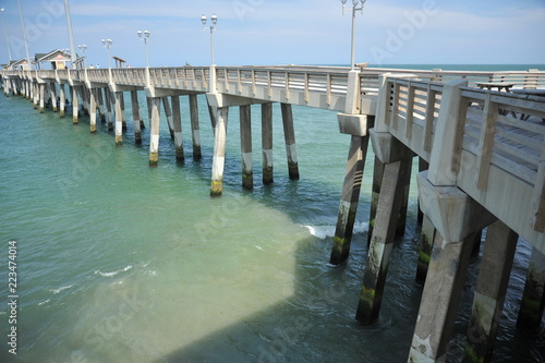View of a pier extending into the ocean