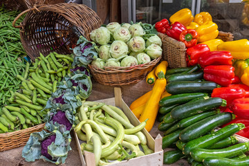 Courgettes, kohlrabi and other vegetables for sale at a market in Brixton, London
