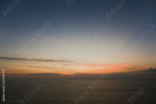 Fotografia  Sea landscape and sunrise sky in background