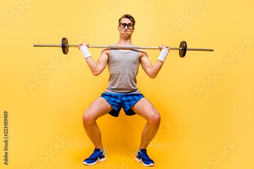 Photo sur Toile Fitness Full length body size of funky caucasian guy in glasses, doing p