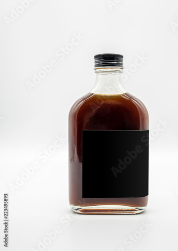 Fotografía Cold Brew Coffee in glass bottle with black cap isolated on white