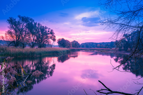 Foto op Plexiglas Purper Magical sunrise over the lake. Misty morning, rural landscape