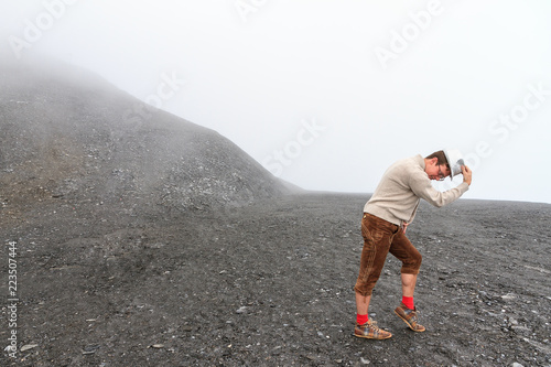 Fotografie, Obraz Humorous individual moonwalking in a moonlike landscape in the mountains of the