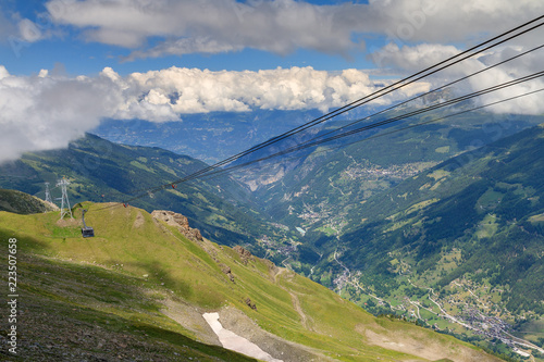 Beautiful summer view of the Grimentz Zinal gondola cable car in Switzerland, region Valais, and the Anniviers valley in the background
