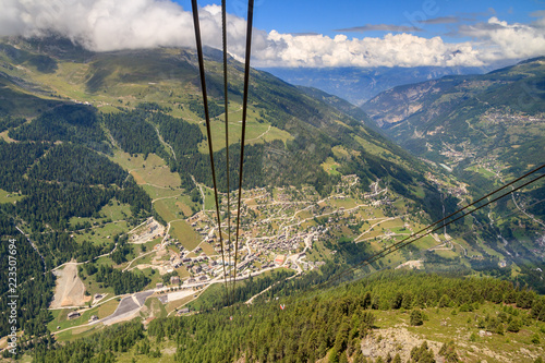 Tuinposter Gondolas Beautiful view of the town Grimentz, Switzerland, region Valais, and the Anniviers valley, seen from the gondola cable car in summer